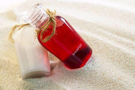 lotion bottle: Lotion bottle on sand