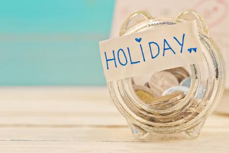 Savings holiday money in a jar Stock Photo