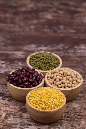 four types of dry beans in the wooden bowl Stock Photo