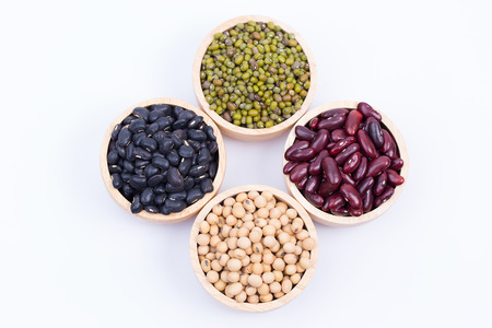 Four types of dry beans in the wooden bowls