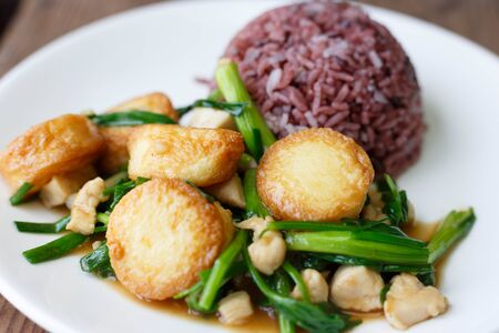 Rice and Deep Fried Tofu with Gravy Sauce.