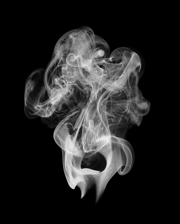 Human scull appearing in smoke