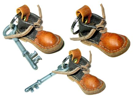 keyholder: Isolated funny leather foot key holder Stock Photo