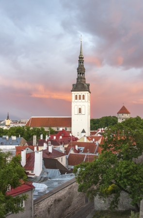 oldtown: St  Nicholas church in Tallinn, Estonia at sunset Stock Photo