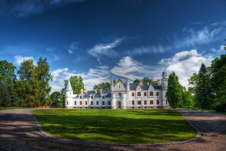 maisonette: A photo of an old small white castle in South of Estonia  Editorial