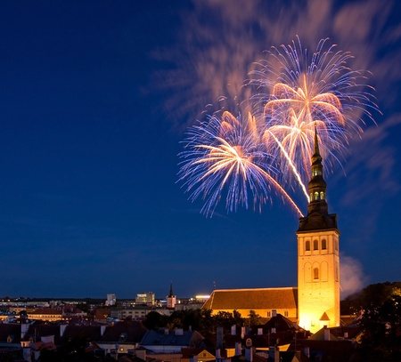 Fireworks in the Old Town of Tallinn, the capital of Estonia, Europe  In front of fireworks there is a church Saint Nicolas