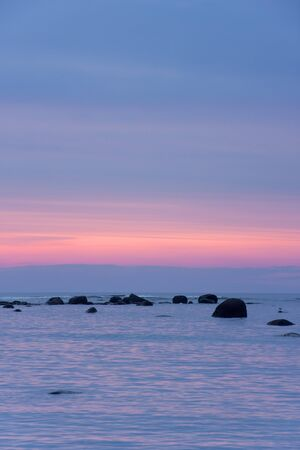 Sunset at sea  Stones in water