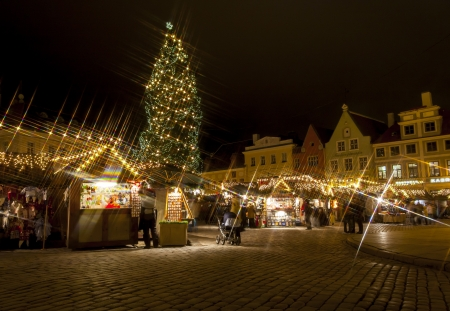Snowless Christmas market around fir tree in the Old Town of Tallinn, Estonia