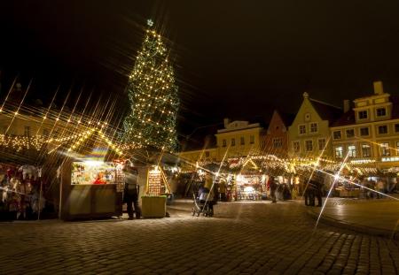 Snowless Christmas market around fir tree in the Old Town of Tallinn, Estonia