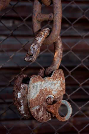 Big old rusty metal open padlock with a key hanging on a bold chain Stock Photo - 15886026