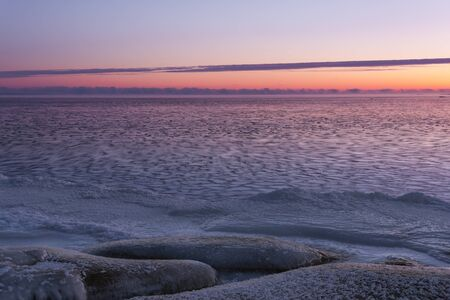 Icy sea at sunrise, snowy land in foreground Stock Photo - 16101794