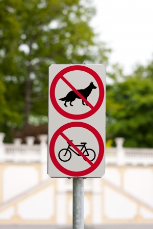prohibits: Traffic sign prohibits entrance for dogs and riders, bicyclists and cyclist Stock Photo