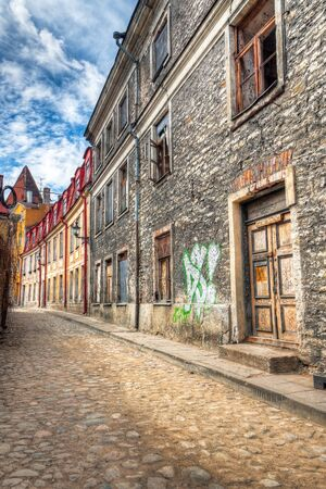 Old abandoned building with graffiti and broken windows in the Old Town of Tallinn, Estonia