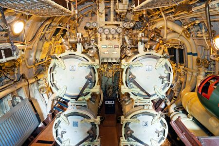 A photo of four torpedo ventages in a submarine  The photo is taken inside an old Estonian submarine called Lembit built just before the World War II
