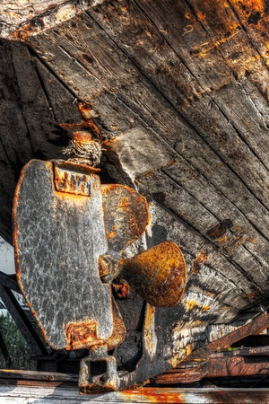 iron made rusty lead screw of and old timber ship photo