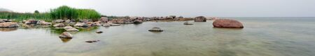 Panorama of a rocky coast at misty weather Stock Photo - 18257333