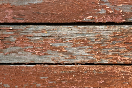skinning: Background of an old timber boards with skinning red or brownish paint