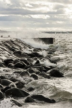 turbulent: Pier in turbulent and stormy sea