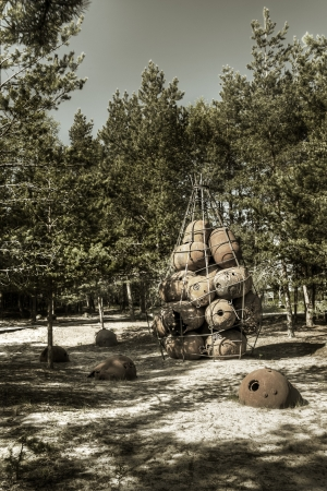 Old rusty mines on the ground and piled at Naissaar, Estonia