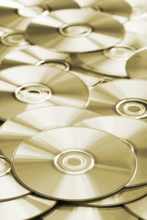 Many CD or DVD disks on each other Stock Photo