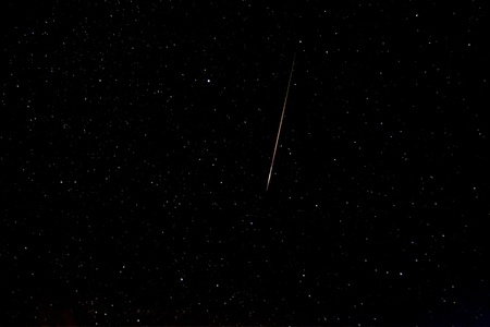 Falling star known as perseid in the sky