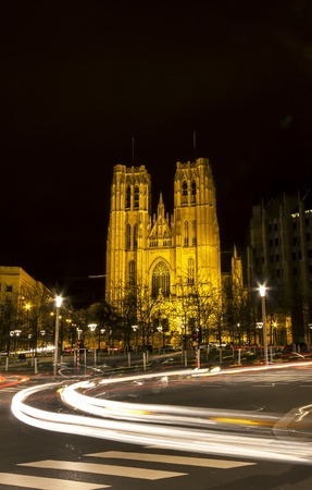 Vehicle light trails in front of Saint Michaels church in Brussels, Belgium at night