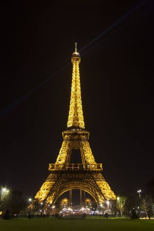 Golden tower of Eiffel at night in Paris, France Editorial