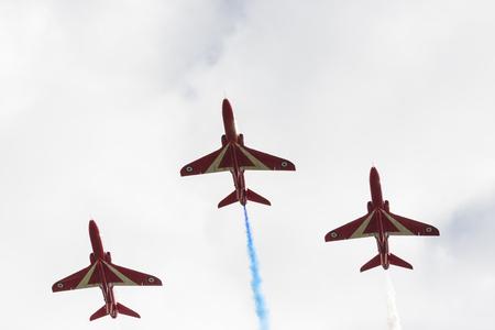 aerobatic: Tallinn, Estonia - June 23, 2014  Red Arrow aerobatic flight show with red fighter jets in Tallinn, Estonia on June 23, 2014 Editorial
