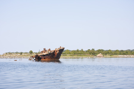ship wreck: Old rusty ship wreck in the sea Stock Photo