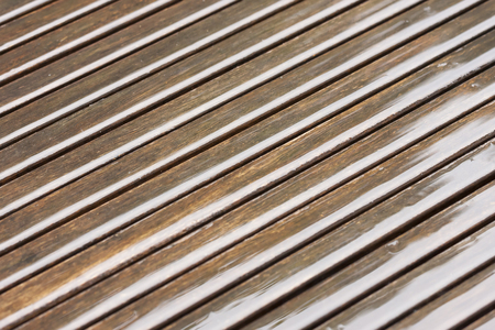 diagonal lines: Brown wet wood lines in diagonal order Stock Photo