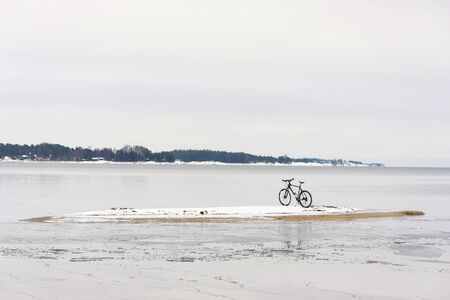 Bicycle on a small island in sea at winter