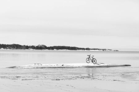 velocipede: Bicycle on a small island in sea at winter