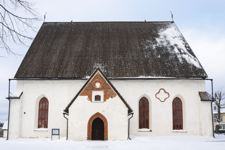 Small ancient white church in the old town of Porvoo, Finland in snowy winter day