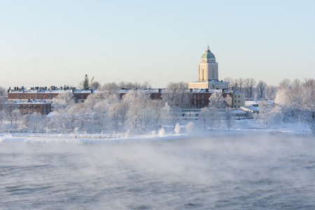 winter finland: Suomenlinna isle and its buildings in Helsinki, Finland in a steaming sea at winter Stock Photo