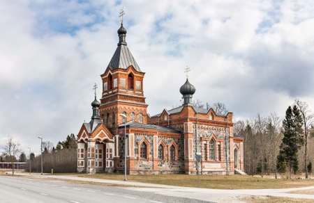 Old chapel made or red bricks and cobble stones in Kohila, Estonia