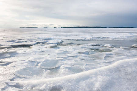Winter landscape of frozen sea at gloomy day