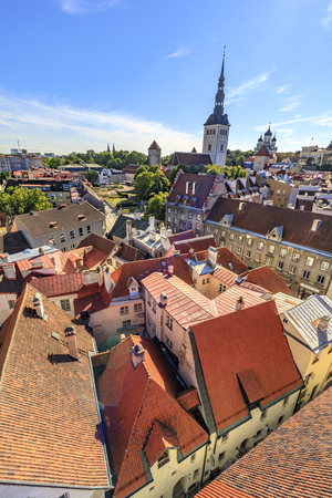 TALLINN, ESTONIA - JULY 26, 2017: Church St. Nicholas and red roofs of the buildings in the old town of Tallinn, Estonia on July 26, 2017