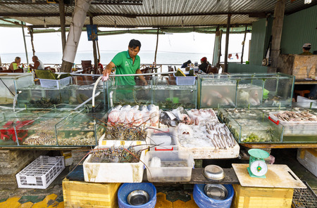 NAM TIEN, VIETNAM - FEBRUARY 15, 2018: Aquariums and bowls filled with fresh seafood in a restaurant in Nam Tien, Vietnam on February 15, 2018 Editorial