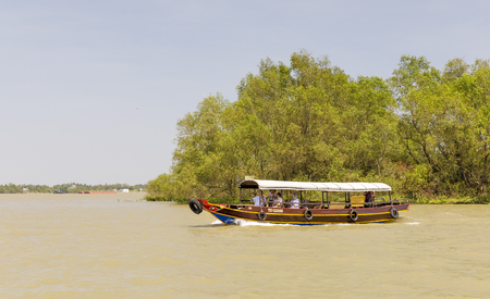 MY THO, VIETNAM - FEBRUARY 24, 2018: Tourist boat rides on Mekong river delta in Vietnam Editorial