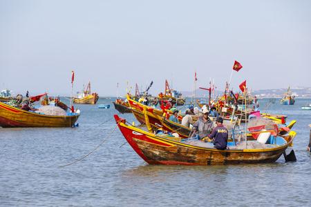 MUI NE, VIETNAM - FEBRUARY 22, 2018: Fishing harbor full of boats in a bay in Mui Ne, Vietnam Editorial