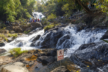 DA LAT, VIETNAM - FEBRUARY 20, 2018: Tourists visit Datanla waterfall in Da Lat, Vietnam