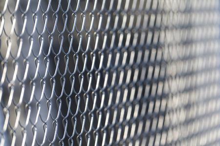 Closeup of solid metal grid fence Banque d'images