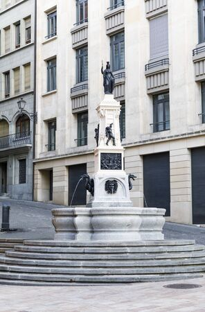 Dringking water fountain with sculpture in the old town of Geneva, capital of Switzerland Stok Fotoğraf