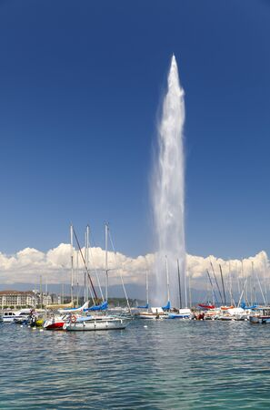 GENEVA, SWITZERLAND - JUNE 30, 2018: 140m high fountain called Jet d'Eau in the city centre of Geneva, Switzerland on June 30, 2018