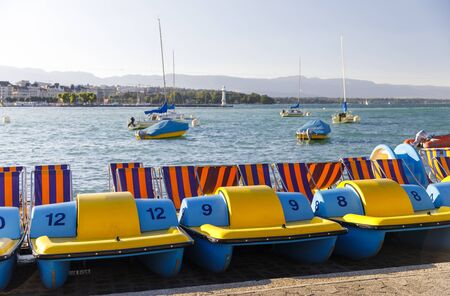 Small colorful waterwheel boats on shore in lake Geneva Standard-Bild