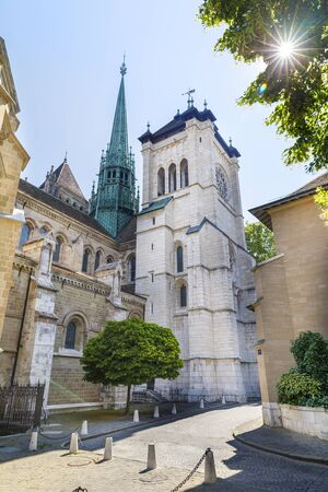 Ancient church towers of Saint Peters Cathedral in historic old town of Geneva, Switzerland