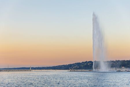 High fountain called Jet deau in the centre of Geneva, Switzerland, at sunset Stock Photo