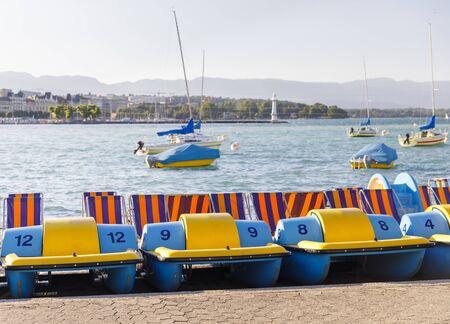 Small colorful waterwheel boats on shore in lake Geneva Stock fotó