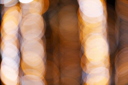 Abstract background with bokeh or blurry round colorful light bubbles