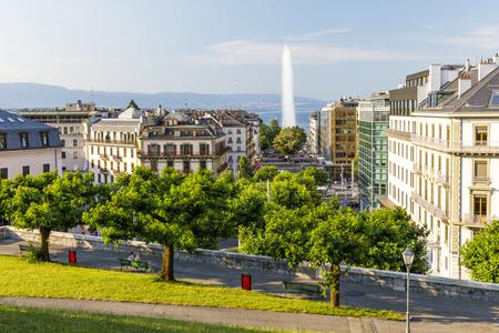 GENEVA, SWITZERLAND - JUNE 29, 2018: Tall fountain called Jet deau above the old town of Geneva, Switzerland in summer 2018